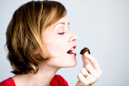 Woman eating chocolate e1428305826131