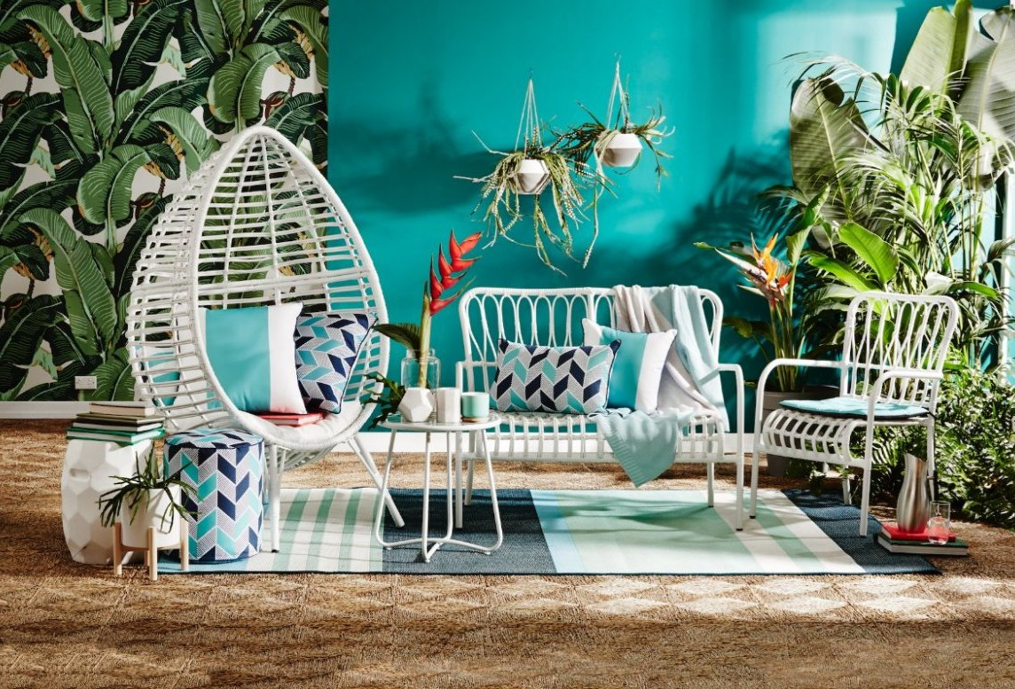 kmart-august-2016-tropical-palm-leaf-wallpaper-and-white-whicker-outdoor-furniture-on-the-life-creative