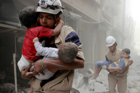 Members of the Civil Defence rescue children after what activists said was an air strike by forces loyal to Syria's President Assad in al-Shaar neighbourhood of Aleppo