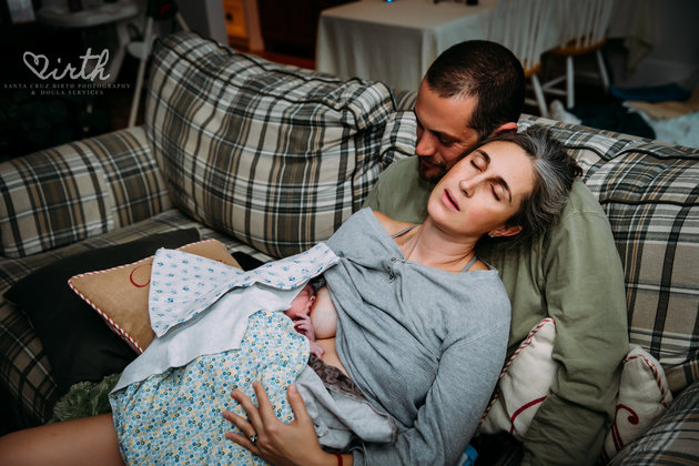 A tired mum after the birth of her fourth son. Image: Santa Cruz Birth Photography Doula Services