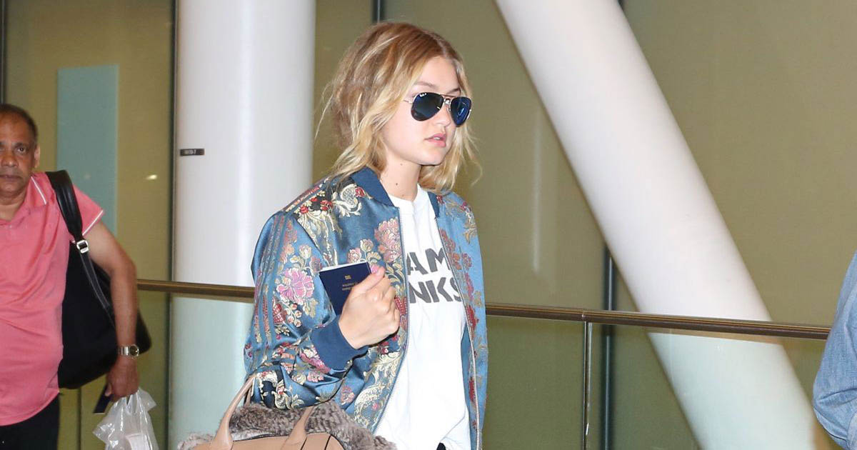 gigi-hadid-arrives-at-airport-in-toronto-macr_jacobs_bag_adidas_originals_jacket_facebook