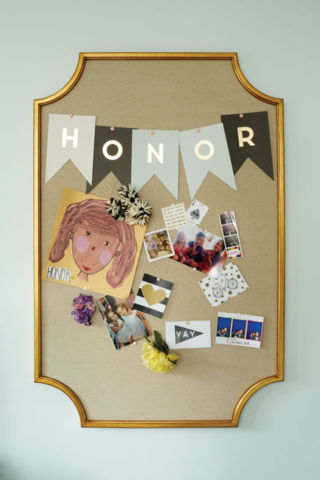 A pin board in Honor's room.
