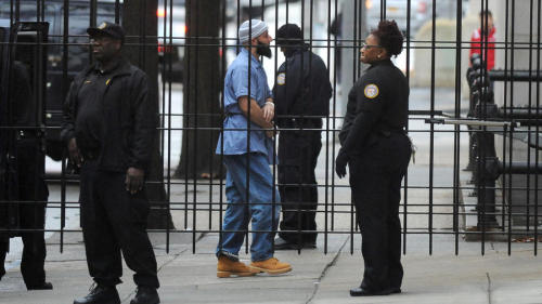 Adnan Syed is escorted into the courthouse on day one