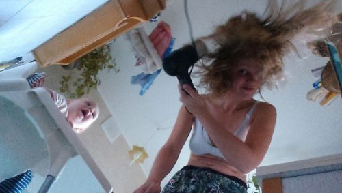 Blow-drying your hair without a high chair could be tricky