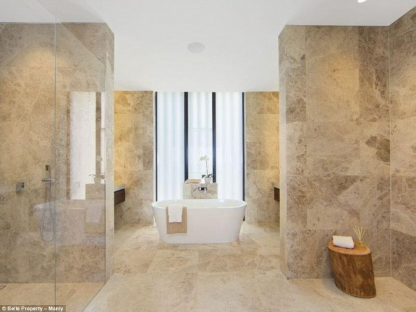 39A78A7500000578-3865964-Clean_Marble_lines_the_walls_and_floors_in_one_main_bathroom-a-17_1477294701134