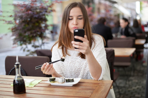 Put the phone down and enjoy those California rolls!