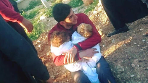 Father Abdul-Hamid Alyousef cradles the bodies of his nine-month-old twins, Aya and Ahmed who died from the Syrian chemical attack. He also lost his wife, two brothers, nephews and other family members.
