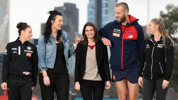 Sam Stynes (centre) is carrying on the work of her husband, Jim.