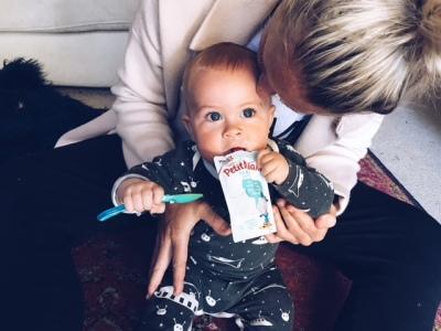 Stacey's son Mack enjoying his Petit Miam Plain Yoghurt pouch